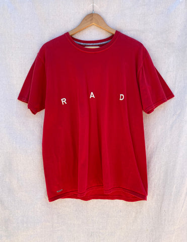 FRONT VIEW T-SHIRT IN RED WITH R A D EMBROIDERY AT CENTER FRONT CHEST.