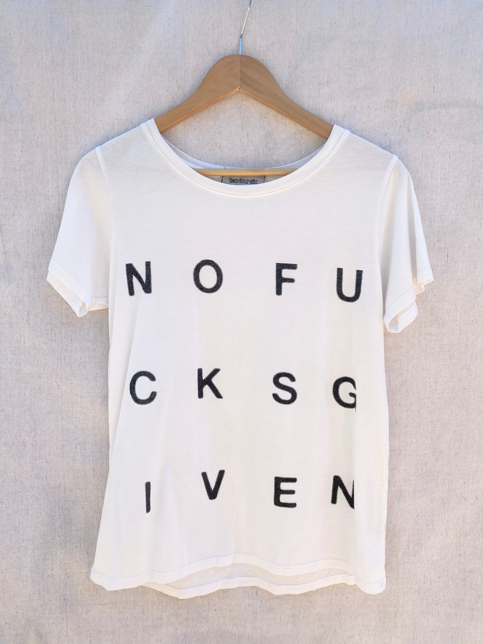FULL FRONT VIEW OF TEE WITH NOFUCKSGIVEN PRINT ON IT.