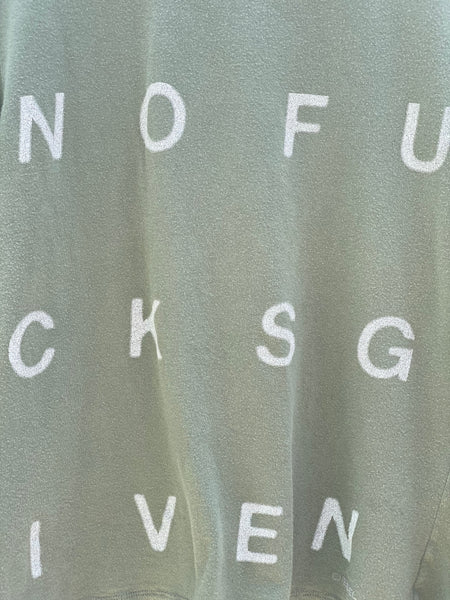 CLOSE UP VIEW NOFUCKSGIVEN PRINT IN IVORY.