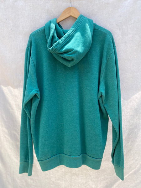 BACK VIEW OF LONG SLEEVE ZIP HOODIE IN AQUA GREEN.