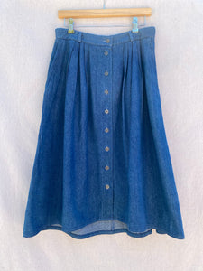 DENIM MIDI SKIRT WITH CENTER FRONT BUTTONS, PLEATS AND SIDE POCKETS.