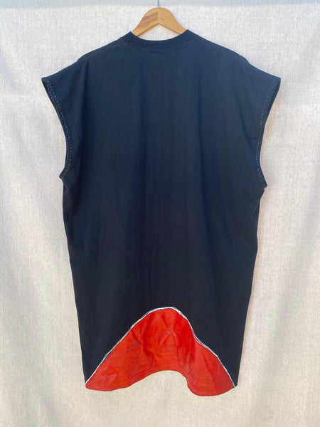 BACK IMAGE OF SLEEVELESS BLACK TEE WITH RED PAINT AT HEM.