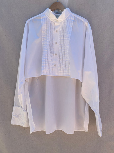 FRONT VIEW OF WHITE BUTTON DOWN TUXEDO SHIRT WITH HI LO HEM.
