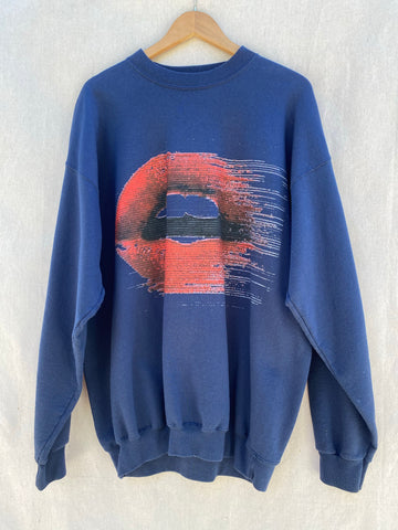 FRONT VIEW OF DARK NAVY SWEATSHIRT WITH PRINTED MOUTH WITH RED LIPS ON IT.