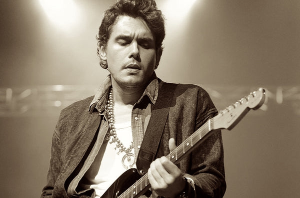 John Mayer performs with a Squash Blossom Necklace