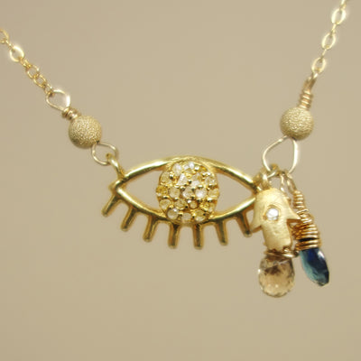 Laurie's Protective Eye necklace: diamond and blue sapphire on gold