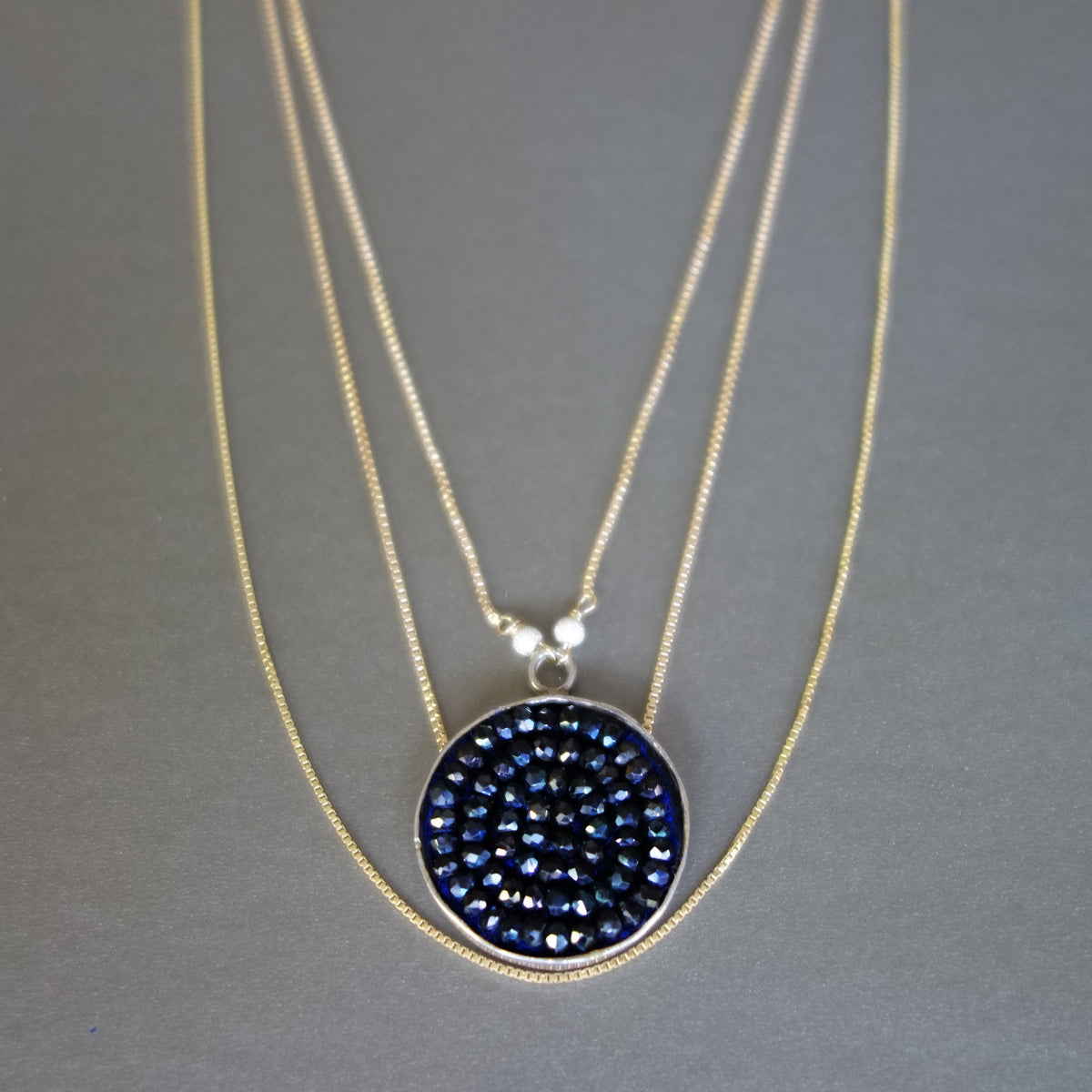 Triple Strand Gold and Blue Sapphire necklace