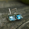 Peace and Harmony: peridot and Swiss blue topaz ear