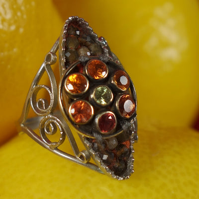 Tequila Sunrise ring: sapphire and andalusite