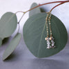 Rhudalated crystal quartz on chain ear in gold or silver