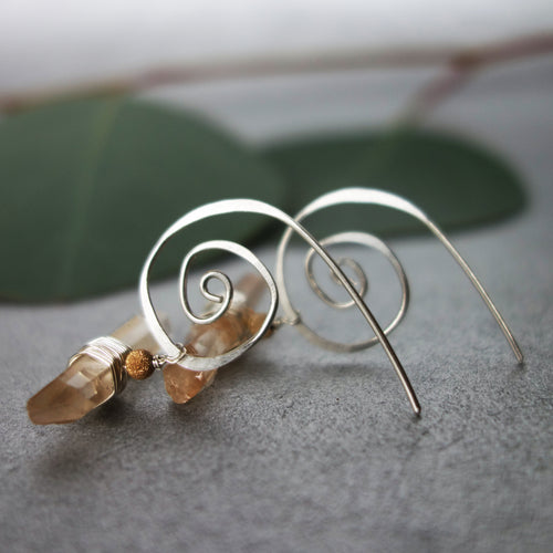 Natural Clear Quartz on Hand Hammered Silver earring