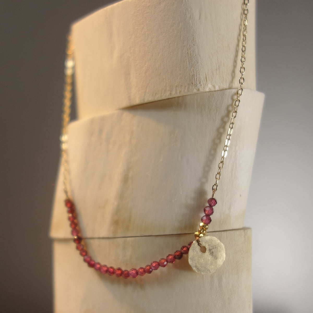 She Spoke Without Words (garnet and gold necklace)