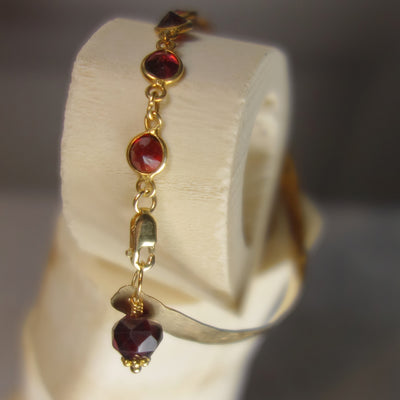 Mr. Darcy, I Presume (hand hammered gold, garnet bangle)