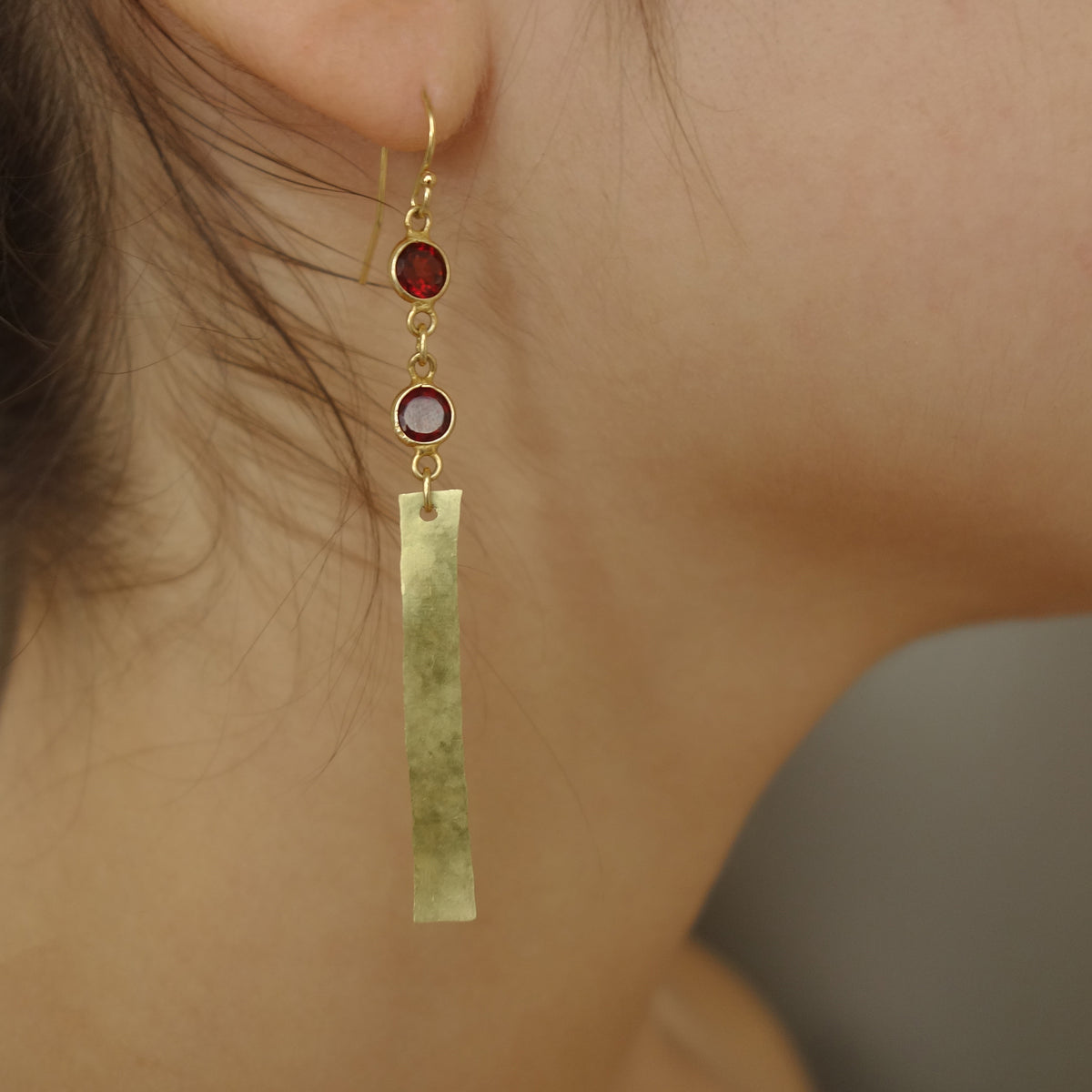 She Shines like Gold in the Sun (garnet, gold, and brass earring)