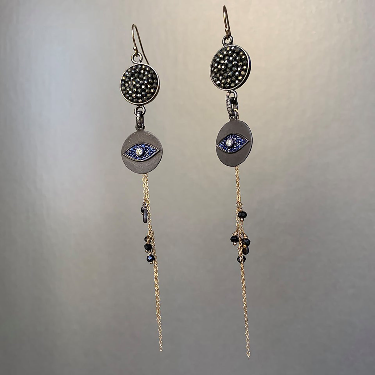 The Bluest Eye diamond, pyrite, and blue sapphire mosaic ear