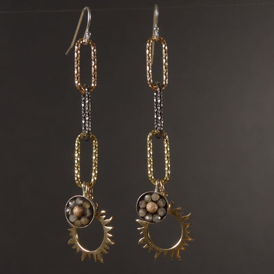 It's a New Dawn mosaic earring of gold, rose gold, and silver