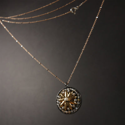 Alexander's Sun Symbol: one of a kind necklace: gold and tundra sapphire