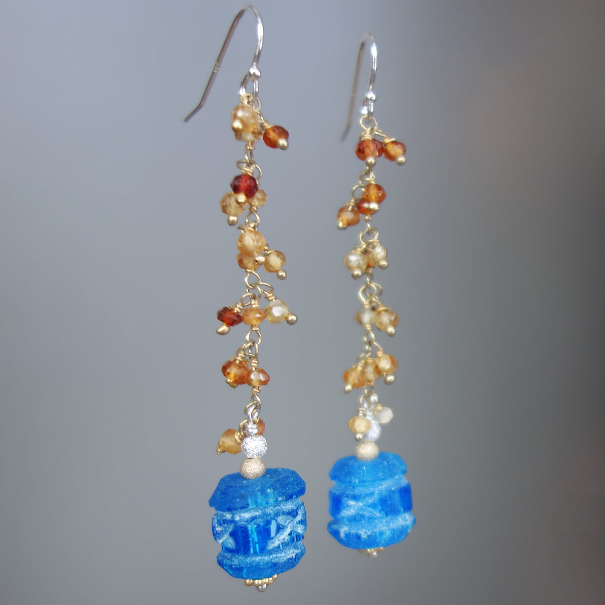 Carved apetite and hessonite garnet earring