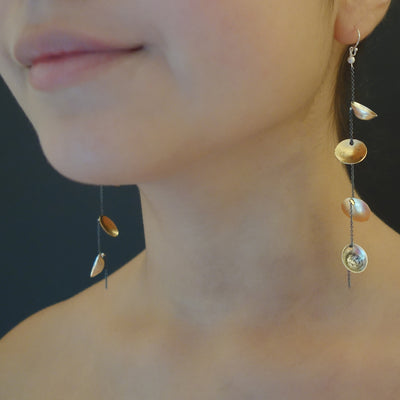 Balancing Act hand hammered gold/silver earrings