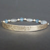 Bangle Me Beautiful (hand hammered gold and blue topaz bracelet)