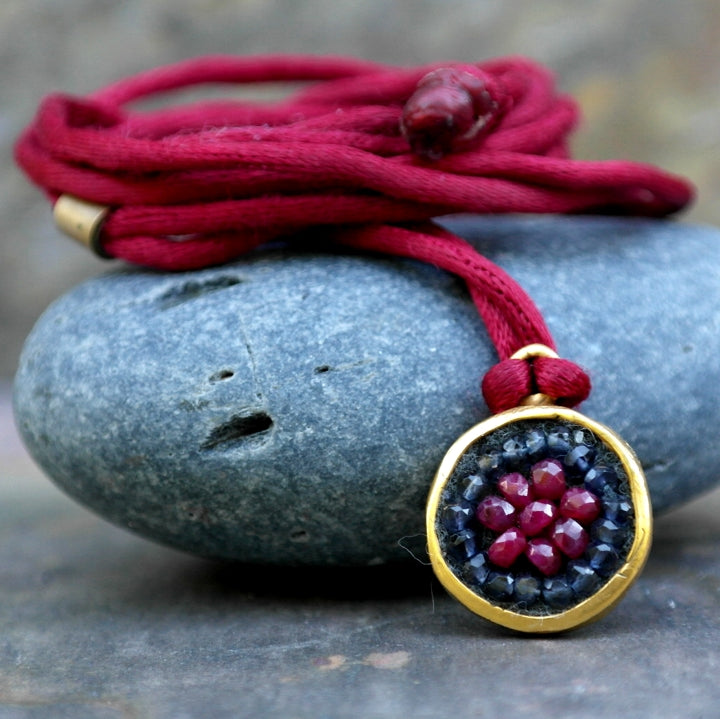 Ruby and iolite on silk