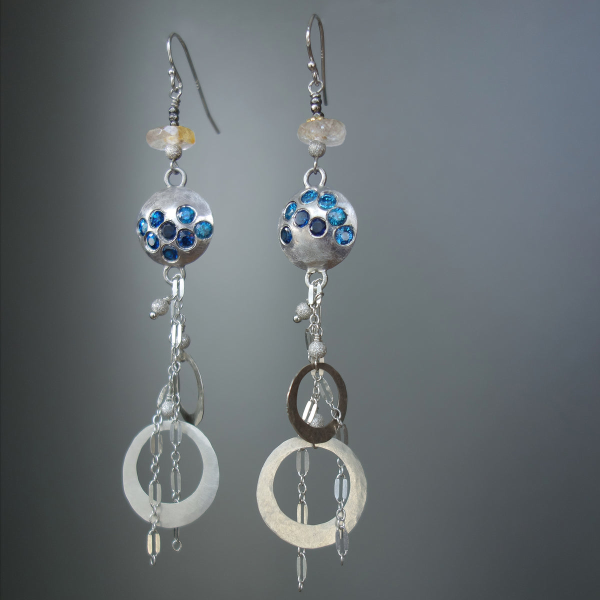 Waterfall earring of zircon and hand hammered silver