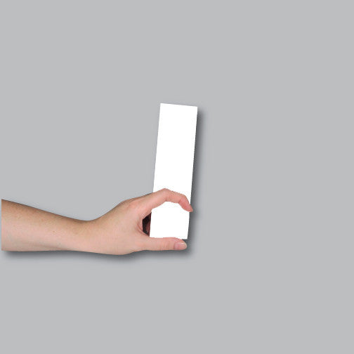 Demonstrating the size of a 2x7 bookmark or ticket