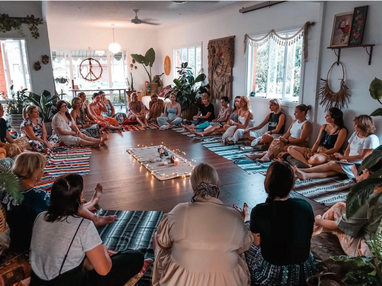Girls sitting in a circle in large open craft space