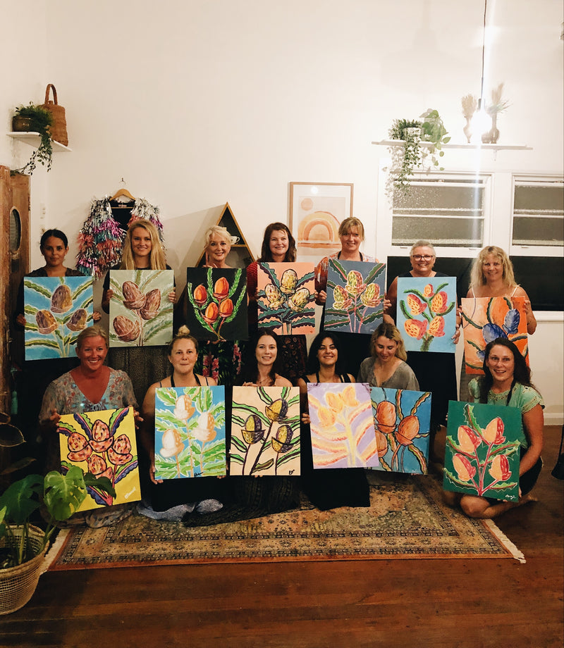 Class of ladies with their finished botanical paintings in all different styles