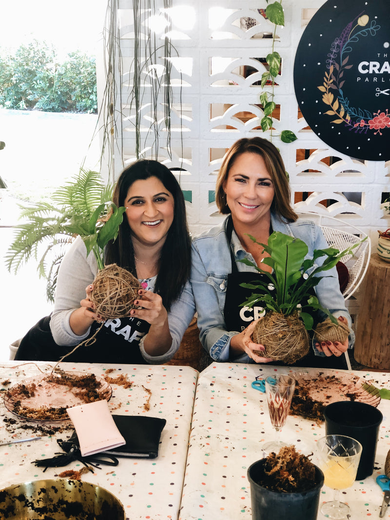 Two ladies at The Craft Parlour kokedama string garden workshop