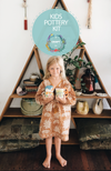 Girl with her hand made pottery mugs at The Craft Parlour kids pottery class