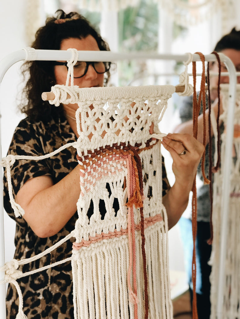 Lady making her macrame weaving at The Craft Parlour