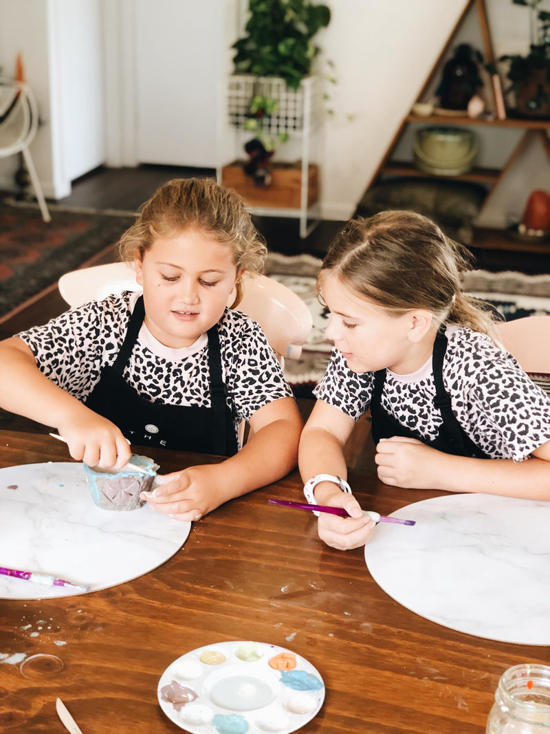 Two kids learning to make a pottery mug at The Craft Parlour pottery workshop