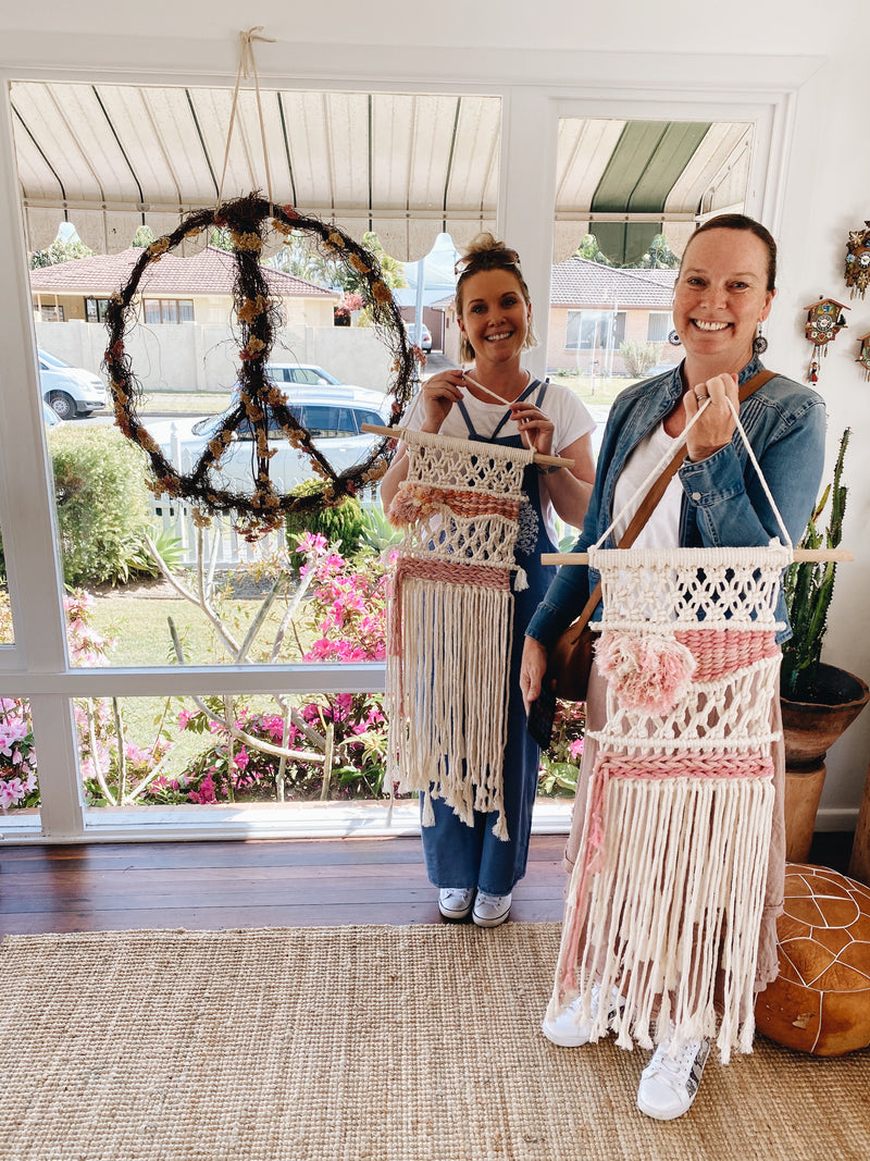 Two ladies with their beautiful handmade macrame wall hangings in the front of The Craft Parlour