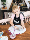 Young girl making a clay cup at kids pottery workshop Gold Coast