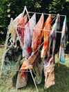 Lots of hand dyed pillowcases drying in the sun