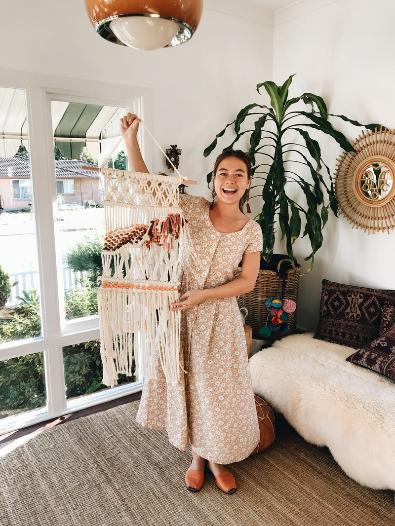 Happy lady with her handmade macrame wall Hhanging