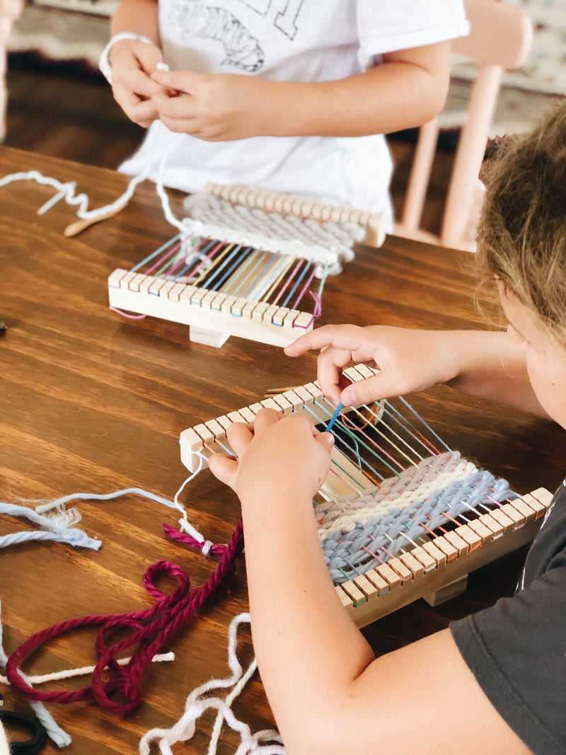 Kids loom weaving with colourful yarn at The Craft Parlour workshop