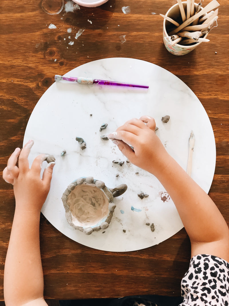 Young girl hand building clay mug at kids pottery class Gold Coast