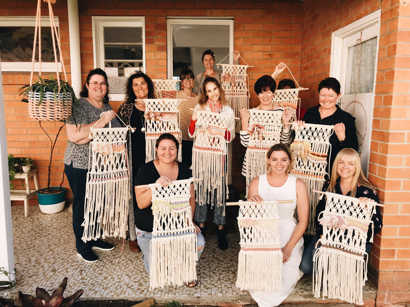 Group of ladies at the front of The Craft Parlour with their macrame weavings