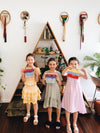 Three young girls with their handmade loom weaving masterpieces at Gold Coast kids craft party