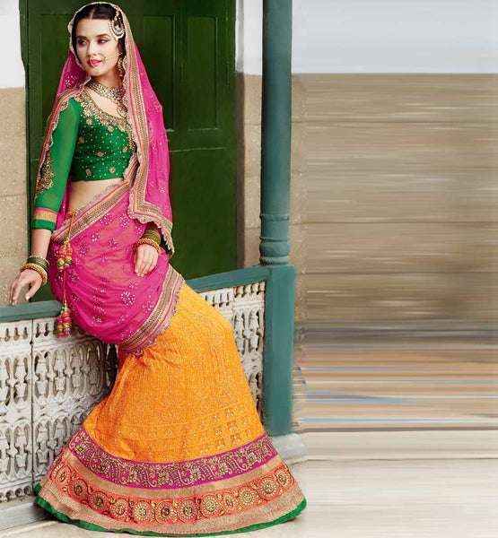Designer Indian Brdial wear Orange Ghagra with green choli shopping.