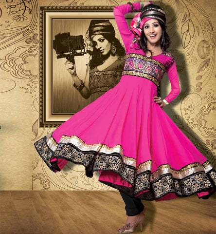 Dark pink anarkali with embroiderded neck and broad layered hemline.