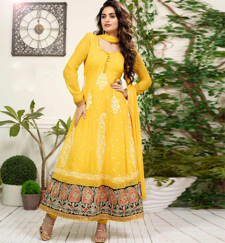 Elegant Yellow embroidered party wear salwar suit with rich lace boder look ar Rs. 2525.00 only.