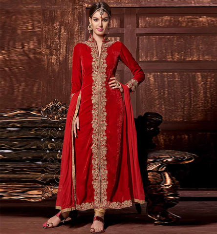Red velvet embroiderd and stonework salwar suit.