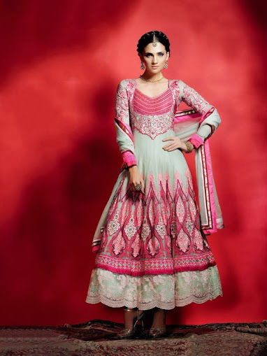 Mint and Pink Embroidered Anarkali Salwar Kameez is sure to meet your most dire fashion needs. The embroidery work on this piece done with resham, stone, and net appliques. The entire ensemble makes an excellent wear. Matching santoon churidar and chiffon dupatta are included with this stunning anarkali.