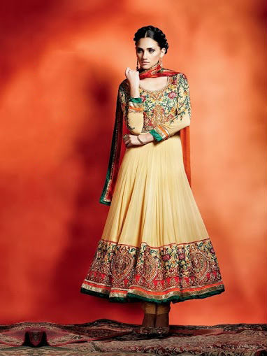 Stylish Ensemble Beige Anarkali Suit, A georgette ensemble in dark beige with a tinge of brown, floral emroidery on sleeves & border with hues of orange green gold & red comes with bright orange dupatta & matching chunidar.