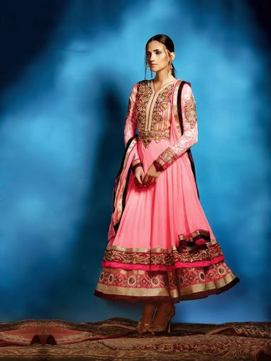 Light Pink Embroidered Anarkali Salwar Kameez is sure to meet your most dire fashion needs. The embroidery work on this piece done with resham, stone, and net appliques. The entire ensemble makes an excellent wear. Matching santoon churidar and chiffon dupatta are included with this stunning anarkali