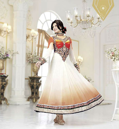 Make a Grand entry with this beautiful and Stunning Off-White-Orange Shaded Long Length Bollywood Style Designer Anarkali outfit. This outfit is created from luxurious Poly Georgette Fabric. The Kameez crafted in Striking Orange Contrast look makes it a winner. The Back look is equally striking. The work on Sleeves is simply outstanding. You surely will look like a princess in this extra-ordinary attire. It is provided with an equally beautiful Chiffon Dupatta and shantoon Churidar.