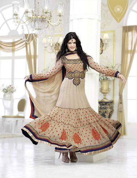 Flaunt your Style quotient with this Marvelous Dark Cream Color full length Pure Georgette Anarkali Outfit. Fresh Orange Color Contrast work along the Dress looks absolutely stunning. Beautiful work on this dress is done with resham, zari, sequins, stone and latken work. Ethnic Butta work or the Scattered Dotted patterns makes the sleeves stand out. The Border of the Suit has stylish Ethnic Gota and lace work. A dash of Black around the Sleeves and the border adds a fresh tone. You surely will look like a princess in this extra-ordinary attire. It is provided with a equally beautiful Chiffon Dupatta and shantoon Churidar.